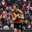 Wolverhampton Wanderers' Richard Stearman, celebrates scoring his side's first goal of the game with his team-mates during the English FA Cup, fourth round match Liverpool vs Wolverhampton Wanderers at Anfield, Liverpool, England, Saturday Jan. 28