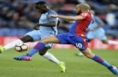 Manchester City's Bacary Sagna, left, and Crystal Palace's Andros Townsend battle for the ball during the Emirates FA Cup, fourth round soccer match at Selhurst Park, London, Saturday Jan. 28, 2017. (Daniel Hambury/PA via AP)