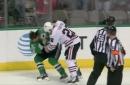 Jordin Tootoo drops Antoine Roussel in fight during Blackhawks-Stars