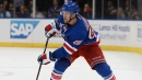 Rangers give coach milestone win, Holtby shuts out Hurricanes