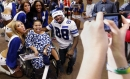The best Dez Bryant photos: Signing a baby, doing the dougie, balling with Michael Irvin and more