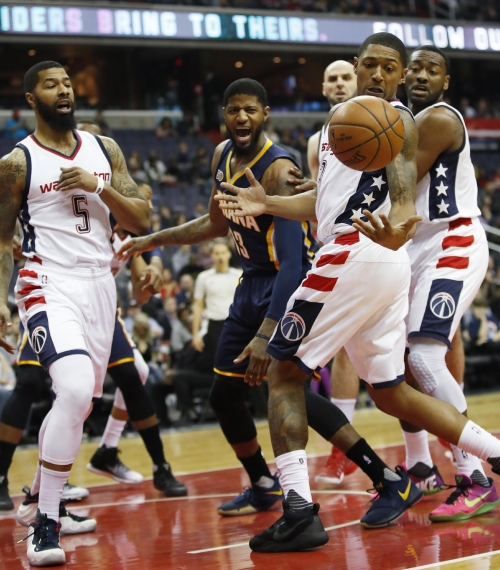 John Wall's late flurry lifts Wizards past Pacers 112-107 The Associated Press