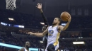 Green gets rare triple-double as Warriors beat Grizzlies