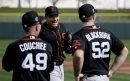 Mark Melancon throws to Buster Posey on Day 1 with Giants The Associated Press