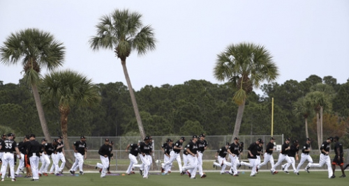 New stage of grieving for Miami Marlins as camp opens The Associated Press