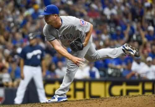 Ex-Cub Warren on Series: 'Being on outside looking in was tough'