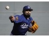 Sergio Romo wearing Dodger blue, much to family's liking