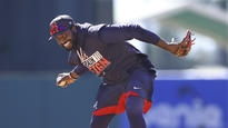 Braves' Phillips happy to be traded back home