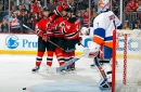 Devils survive late onslaught by Islanders, win 3-2 at home.