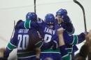 Tanev scores in overtime, Canucks edge Flames 2-1