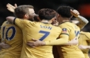 Tottenham Hotspur's Harry Kane, left, celebrates with teammates after scoring during the English FA Cup soccer match between Fulham and Tottenham Hotspur at Craven Cottage stadium in London, Sunday, Feb. 19, 2017.(AP Photo/Frank Augstein)