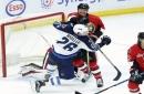 Hellebuyck makes 32 saves, Jets hold off Senators 3-2 The Associated Press