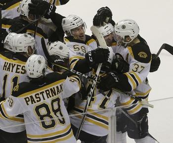 Bruins beat Sharks in OT