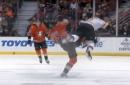 Ducks defenseman sends Brad Marchand airborne with big open-ice hit
