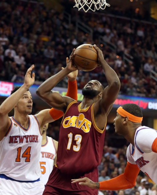 Cleveland Cavaliers' Tristan Thompson blocks Derrick Rose, gets rebound slam (video)
