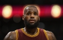 James triple-double lifts Cavaliers over Knicks
