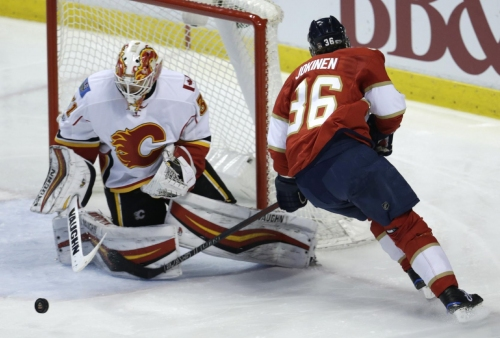 Johnson leads Flames past Panthers 4-2 for 3rd straight The Associated Press
