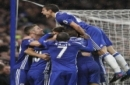 Chelsea players celebrate the goal of Chelsea's Diego Costa, hidden, during the English Premier League soccer match between Chelsea and Swansea City at Stamford Bridge stadium in London, Saturday, Feb. 25, 2017. (AP Photo/Kirsty Wigglesworth)