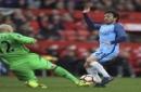 Middlesbrough goalkeeper Brad Guzan, left, blocks Manchester City's David Silva during the English FA Cup quarter final at the Riverside Stadium in Middlesbrough, England, Saturday March 11, 2017. (Mike Egerton/PA via AP)
