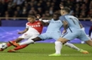 Monaco's Kylian Mbappe, left, challenges for the ball with Manchester City's Bacary Sagna while Manchester City's Aleksandar Kolarov, right, looks on during a Champions League round of 16 second leg soccer match between Monaco and Manchester C