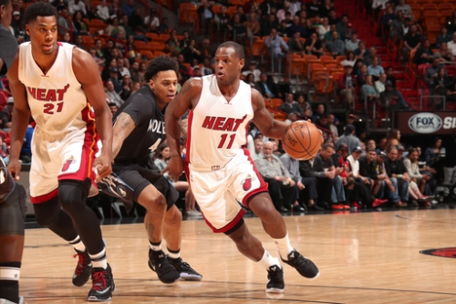 Heat pull away late, top Timberwolves 123-105 The Associated Press