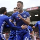 Chelsea's Gary Cahill, centre, celebrates after scoring during the English Premier League soccer match between Stoke City and Chelsea at the Britannia Stadium, Stoke on Trent, England, Saturday, March 18, 2017. (AP Photo/Rui Vieira)