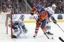 Talbot makes 33 saves, Oilers blank Canucks 2-0 The Associated Press