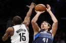 Dirk Nowitzki scores 23 to lead Mavericks over Nets, 111-104