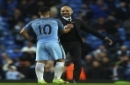 Manchester City's Sergio Aguero, left, shakes hands with Manchester City manager Pep Guardiola at the end of the English Premier League soccer match between Manchester City and Liverpool at the Etihad Stadium in Manchester, England, Sunday March 19, 2