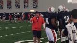 Auburn OL coach Herb Hand working with OTs Darius James & Prince Sammons