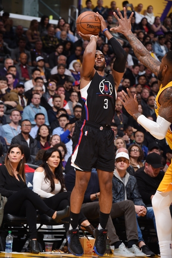 Paul leads Clippers in blowout, watches end with young son The Associated Press