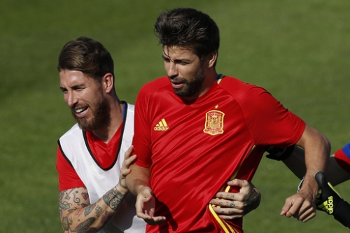 In national team, Pique and Ramos back to being friends The Associated Press