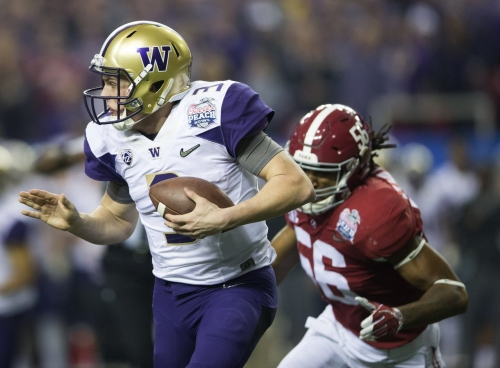 UW's Jake Browning limited during first spring football practice