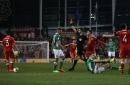 Aston Villa defender Neil Taylor reaches out to Seamus Coleman
