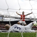 Arsenal's Theo Walcott, center, celebrates after his teammate Arsenal's Shkodran Mustafi scored their second goal past Manchester City goalkeeper Willy Caballero, foreground, during the English Premier League soccer match between Arsenal and Manch