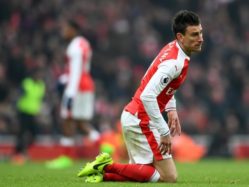 Arsenal players Laurent Koscielny, Theo Walcott and Mesut Ozil singled out for criticism by Gary Neville