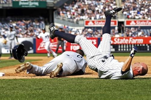 Yankees Brett Gardner, Rays Rickie Weeks Jr. caught in brutal collision at first base