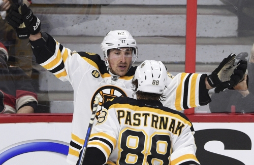 Brad Marchand breaks late tie, Bruins top Senators in Game 1