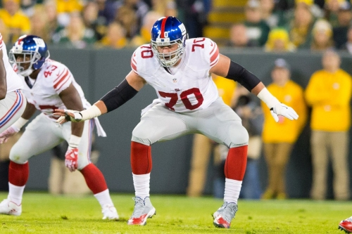 Weston Richburg played with torn hand ligaments last season