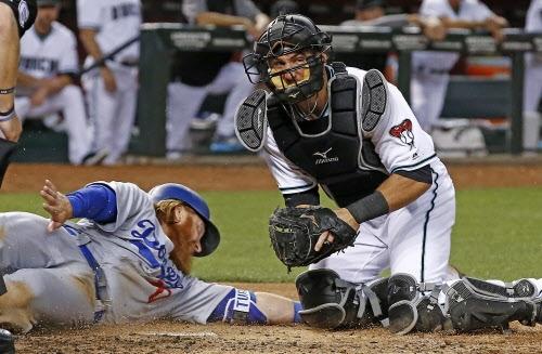 Dodgers' bullpen implodes in nine-run inning