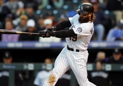 Suddenly slugging Rockies rout the Giants at Coors Field with a season-high hit mark