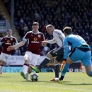 Manchester United's Wayne Rooney, centre right, in action to score his side's second goal of the game against Burnely, with Wayne Rooney, right, during their English Premier League soccer match at Turf Moor in Burnley, England, Sunday April 23, 20