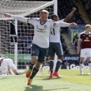 Manchester United's Wayne Rooney celebrates scoring his side's second goal of the game against Burnely during their English Premier League soccer match at Turf Moor in Burnley, England, Sunday April 23, 2017. (Martin Rickett/PA via AP)