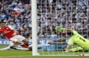 Arsenal's Alexis Sanchez, left, scores his side's second goal past Manchester City goalkeeper Claudio Bravo, right, during the English FA Cup semifinal soccer match between Arsenal and Manchester City at Wembley stadium in London, Sunday, April 23
