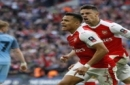 Arsenal's Alexis Sanchez, center, celebrates after scoring his side's second goal during the English FA Cup semifinal soccer match between Arsenal and Manchester City at Wembley stadium in London, Sunday, April 23, 2017. (AP Photo/Kirsty Wiggleswo