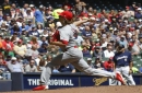 Leake helps himself at plate as Cardinals win