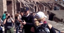 LOOK: Michigan coach Jim Harbaugh breaks out selfie stick in Rome's version of the Big House