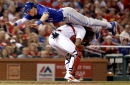 Chris Coghlan dives over Yadier Molina with the slide of the year to avoid tag at home