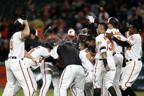 O's win 5-4 over Nationals in 12 innings