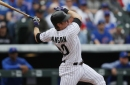 Veteran catcher Ryan Hanigan guides another young Rockies pitcher to a win